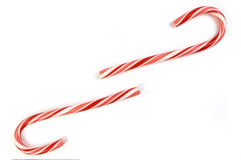 Candy canes. Two candy canes on white background with space between for copy Stock Image