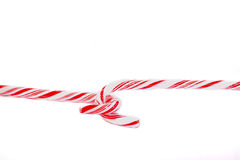 Candy canes. Traditional holiday candy canes hooked together and isolated on white backgrounds Royalty Free Stock Image