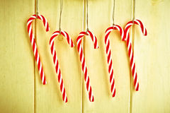 Candy canes. Nice vintage toned image of 5 candy canes hanging Stock Photography