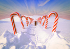 Candy canes. 3d render of Candy canes path with gift Royalty Free Stock Photography