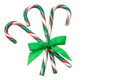 Candy Canes. Three candy canes, tied together with green ribbon, isolated on white Royalty Free Stock Image