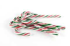 Candy canes alpha. Green, red and white striped candy canes royalty free stock images