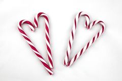 Candy Canes arranged in a heart shape. royalty free stock photos