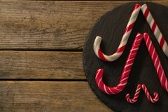 Candy canes arranged on wood Royalty Free Stock Images