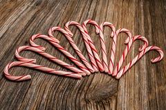 Candy canes,barnwood,background Stock Photo