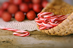Candy canes in basket Stock Images