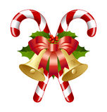 Candy canes and bells. Candy canes decorated with bells, holly and ribbon Stock Photos