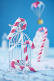 Candy canes on blue background. Extreme shallow depth of field with selective focus on center candy Stock Image