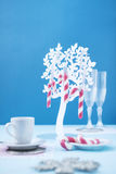 Candy canes on blue background. Candy canes in a plastic tree on blue background. Candy canes in a plastic tree on blue background Royalty Free Stock Photo