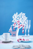 Candy canes on blue background. Candy canes in a plastic tree on blue background. Candy canes in a plastic tree on blue background Royalty Free Stock Image