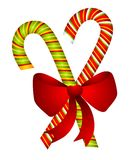 Candy Canes and Bow Isolated Stock Image