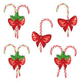 Candy Canes with Bow Set. Collection of tasty striped candy canes with red bow, Christmas sweets Stock Photography