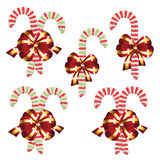 Candy Canes with Bow Set. Collection of tasty striped candy canes with red bow, Christmas sweets Stock Image