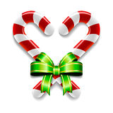 Candy Canes And Bow. A set of two candy canes tied together with a ribbon and bow vector illustration