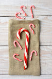 Candy Canes and Burlap Sack Royalty Free Stock Photos