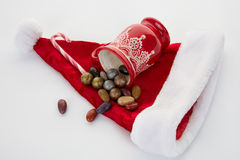 Candy canes, candies and chocolate on Santa hat isolated Stock Photo