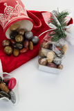 Candy canes, candies and chocolate on Santa hat isolated Royalty Free Stock Images