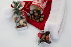 Candy canes, candies and chocolate on Santa hat isolated Stock Photos