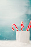 Candy canes. Christmas background. Candy canes on snow, Xmas decoration Royalty Free Stock Photography