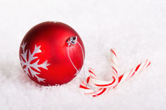 Candy canes with Christmas ball Stock Photography