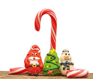 Candy canes and christmas toys Stock Image