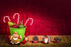 Candy canes with Christmas tree balls in green pot stock photography
