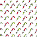 Candy canes colorful seamless pattern. Christmas new year festive background. Sweets hand drawn texture Stock Photography