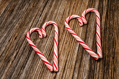 Candy canes,heart,barnwood,background Stock Images