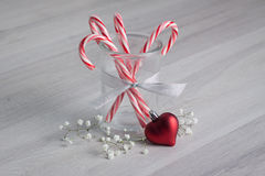 Candy Canes with a Heart Ornament Stock Image