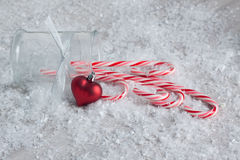 Candy Canes with a Heart Ornament Stock Photos