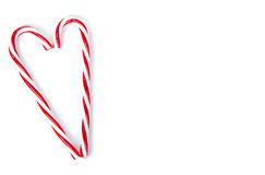 Candy canes in a heart shape Royalty Free Stock Image