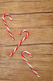 Candy canes. Isolated against a wooden background Royalty Free Stock Photos