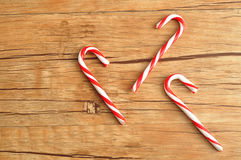 Candy canes. Isolated against a wooden background Stock Photos