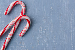 Candy Canes on Light Blue Wood Background Royalty Free Stock Images