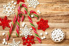 Candy canes. Lollipop with christmas decorations on wooden background Royalty Free Stock Photography