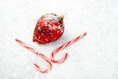 Candy Canes and Ornament lying in the snow Stock Photography