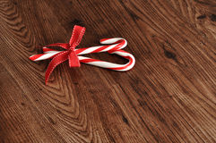 Candy canes with a red bow Stock Photos