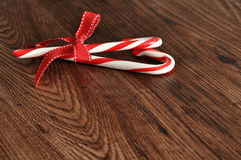 Candy canes with a red bow Stock Images