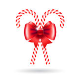 Candy canes with red bow. Royalty Free Stock Photography
