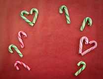 Candy canes on red Stock Photography