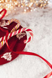 Candy Canes On Red Plate With Christmas Decoration Around Stock Photography