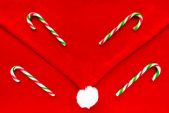 Candy Canes on Santa Hat Christmas Background Royalty Free Stock Photography