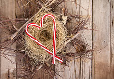 Candy canes in the shape of a heart on a nest Stock Photography