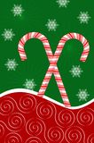 Candy Canes and Snowflakes. Peppermint candy canes on red curve with snowflakes on green background Royalty Free Illustration