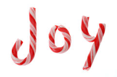 Candy canes spell Joy, on white background; Christmas Royalty Free Stock Images