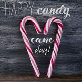 Candy canes and text happy candy cane day stock photo
