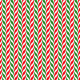 Candy canes vector background. Seamless xmas pattern with red, green and white candy cane stripes. Royalty Free Stock Image