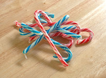 Candy canes on wood counter top Stock Images