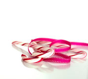 Candy canes wrapped in a decorative ribbon. Celebration and birthday concept. Seasonal holidays stock image