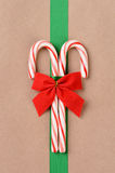 Candy Canes on Wrapped Package Royalty Free Stock Image